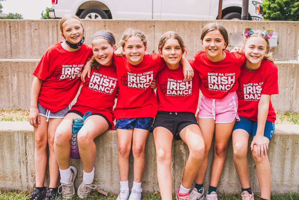 Group of smiling kids in matching t-shirts